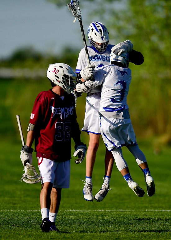 . Dawson School\'s Jack Shams (No. 3) celebrates a goal with teammate Gavyn Pure (No.2) as t Golden High School\'s Colin Mulligan (No. 32) looks on in Lafayette, Colorado on May 16, 2018. (Photo by Matthew Jonas/Staff Photographer)