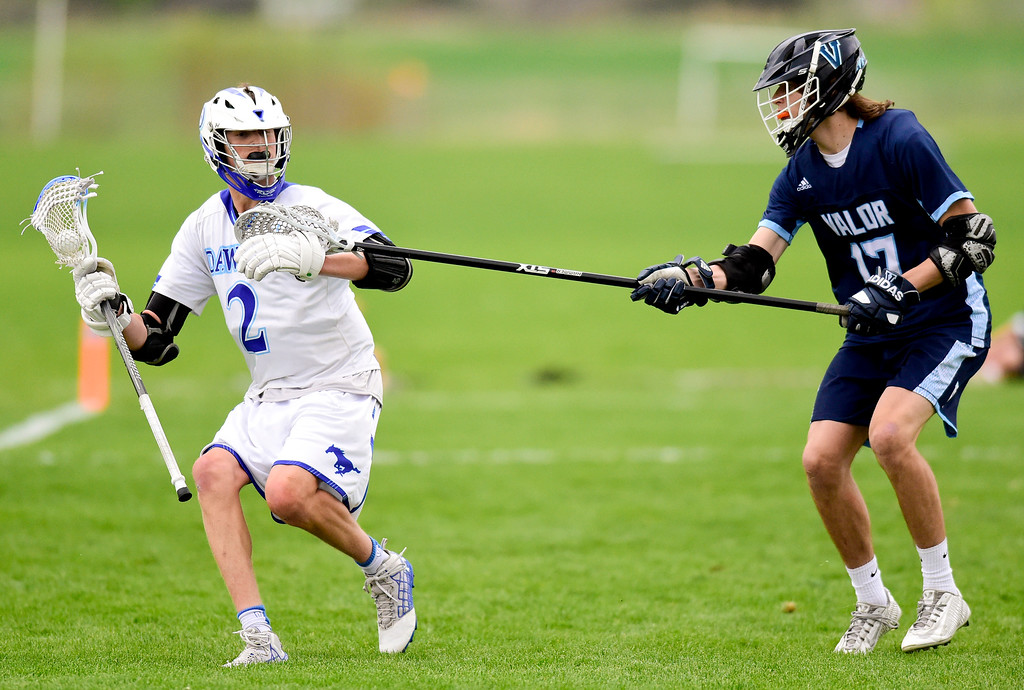 . Dawson School\'s Gavyn Pure (No. 2) is stick checked by Valor Christian School\'s Ben Lowther (No. 17) in Lafayette, Colorado on May 11, 2018. (Photo by Matthew Jonas/Staff Photographer)