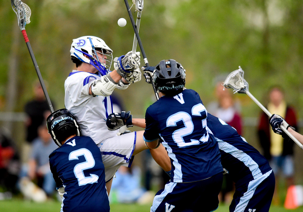. Dawson School\'s Taylor Kamigaki (No. 11) gets tangled up with Valor Christian School\'s Holden Luong (No. 2), Jackson Soderquist (No. 23) and Trey Digby (No. 3) in Lafayette, Colorado on May 11, 2018. (Photo by Matthew Jonas/Staff Photographer)