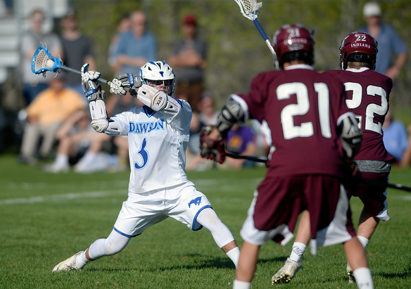 . Alexander Dawson\'s Jack Shams takes a shot over a swarm of defenders during a CHSAA State semi-final game against Cheyenne Mountain on Wednesday in Lafayette. More photos: BoCoPreps.com Jeremy Papasso/ Staff Photographer May 18, 2016