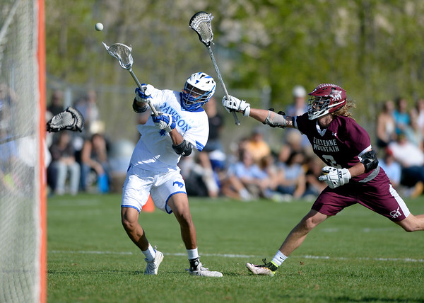 . Alexander Dawson\'s Wyatt Watts takes a shot over Kai Case during a CHSAA State semi-final game against Cheyenne Mountain on Wednesday in Lafayette. More photos: BoCoPreps.com Jeremy Papasso/ Staff Photographer May 18, 2016
