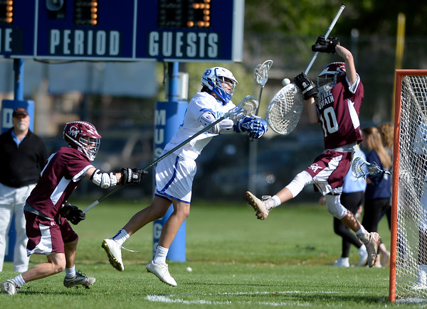 . Alexander Dawson\'s Jesse Rosenblatt tries to score over goalkeeper Luke Paige during a CHSAA State semi-final game against Cheyenne Mountain on Wednesday in Lafayette. More photos: BoCoPreps.com Jeremy Papasso/ Staff Photographer May 18, 2016