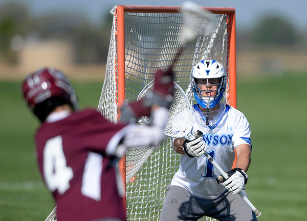 . Alexander Dawson goalkeeper Chad Dunnell protects the goal from a shot from Mark Reynolds during a CHSAA State semi-final game against Cheyenne Mountain on Wednesday in Lafayette. More photos: BoCoPreps.com Jeremy Papasso/ Staff Photographer May 18, 2016