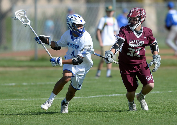 . Alexander Dawson\'s Wyatt Watts moves the ball past Rees Folaron during a CHSAA State semi-final game against Cheyenne Mountain on Wednesday in Lafayette. More photos: BoCoPreps.com Jeremy Papasso/ Staff Photographer May 18, 2016