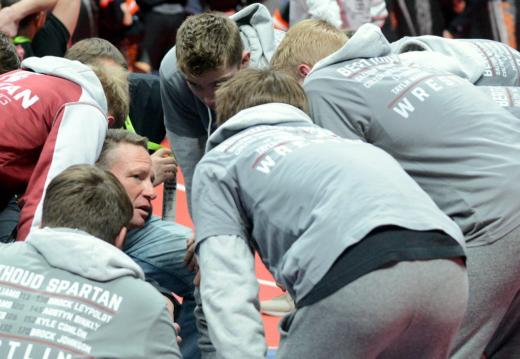 . Berthoud assistant coach Faren Stroh gives the team a pep talk prior to the start of the 3A state wrestling tournament at the Pepsi Center in Denver. (Mike Brohard/Loveland Reporter-Herald)