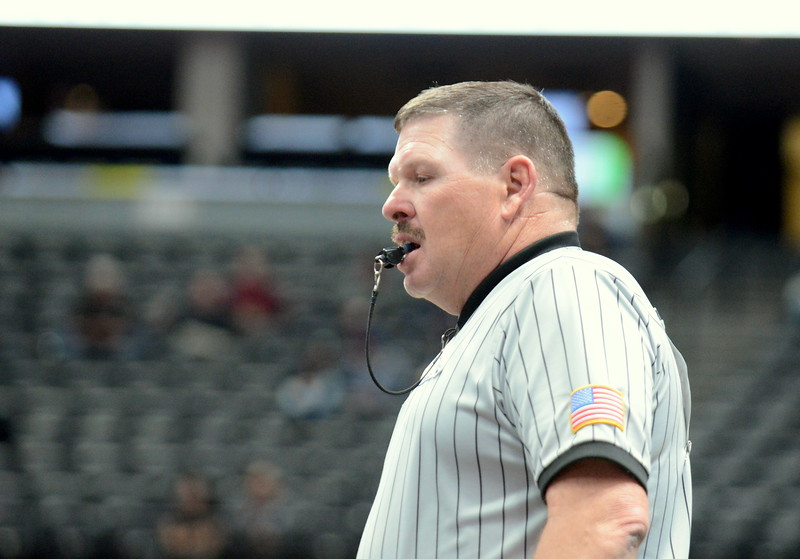 Berthoud official Brad Pickert watches the action at the 4A state wrestling tournament Thursday at the Pepsi Center in Denver. (Mike Brohard/Loveland Reporter-Herald)