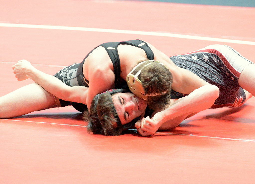 . Berthoud\'s Tayln Massie tries to fight off his back in his 132-pound match with James Thomas of Pagosa Springs on Thursday at the 3A state wrestling tournament at the Pepsi Center in Denver. Massie lost by fall. (Mike Brohard/Loveland Reporter-Herald)