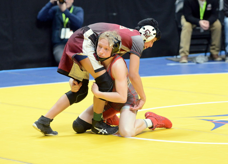 Loveland's Kobi Johnson hits a double-leg takedown he turned into a pin in 28 seconds in his 106-pound match with Nicholas Grizales of Cheyenne Mountain at the 4A state wrestling tournament Thursday at the Pepsi Center in Denver. (Mike Brohard/Loveland Reporter-Herald)