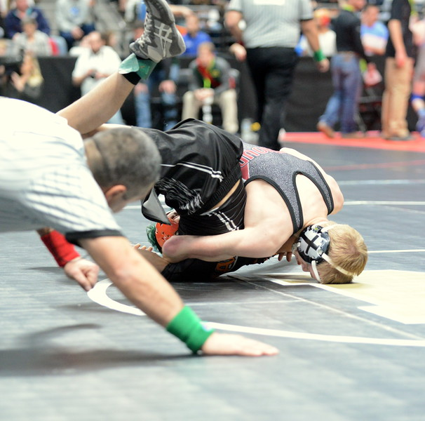 Berthoud's Dalton Williams puts Sterling's Sergio Mendez to his back during their 113-pound match at the 3A state wrestling tournament at the Pepsi Center in Denver. Willaims won by pin in 2:44.  (Mike Brohard/Loveland Reporter-Herald)
