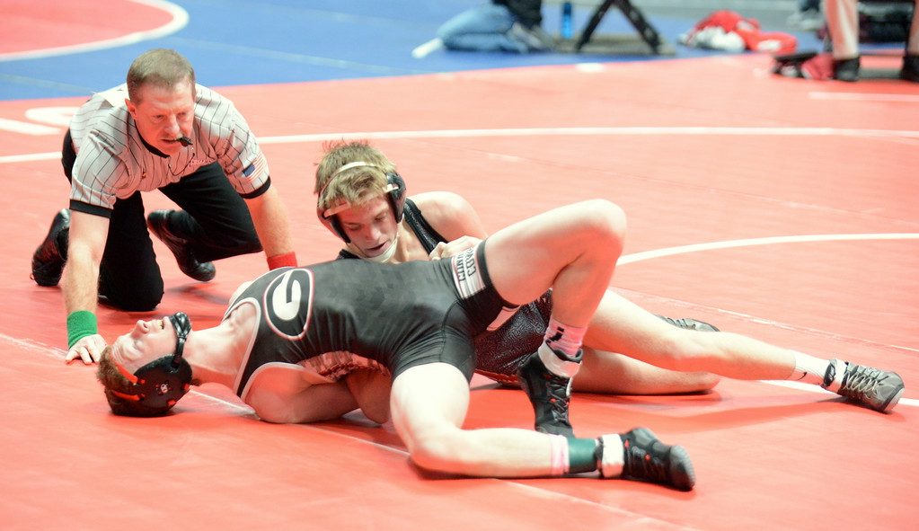 . Colton Williams of Berthoud puts Gunninson\'s Tyler Loudick to his back Thursday at the 3A state wrestling tournament at the Pepsi Center in Denver. Williams won by pin in 3:02. (Mike Brohard/Loveland Reporter-Herald)