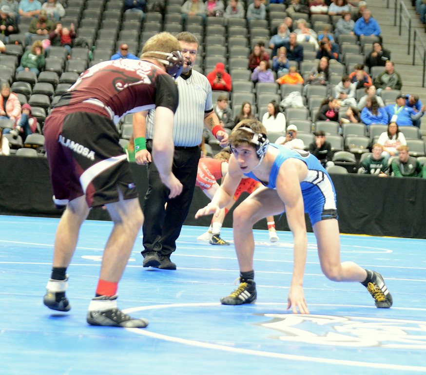 . Resurrection Christian\'s Eddie Lemos looks for an opening in his 132-pound match with Alamosa\'s Colton Liddel at the 3A state wrestling tournament at the Pepsi Center in Denver. Liddel won by technical fall. (Mike Brohard/Loveland Reporter-Herald)