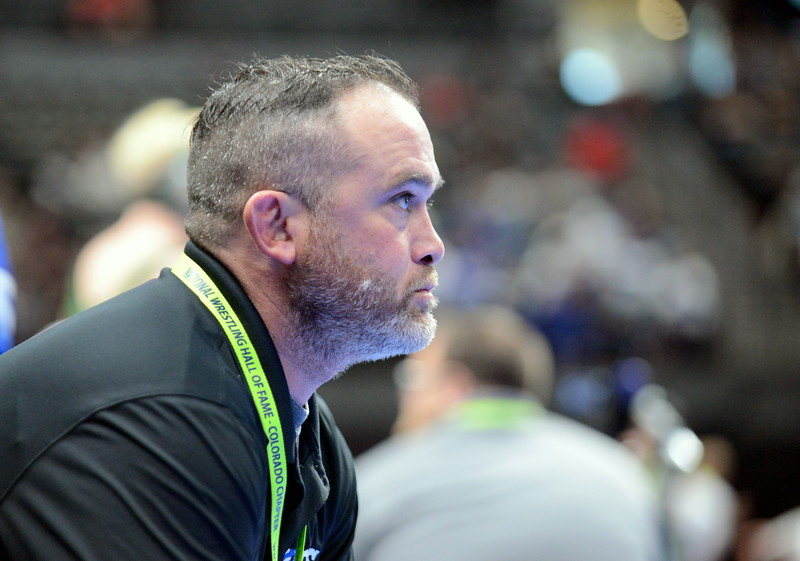 Resurrection Christian coach Bryson Vasquez is all business as he waits for the start of Eddie Lemos' match at 132 pounds at the 3A state wrestling tournament at the Pepsi Center in Denver. (Mike Brohard/Loveland Reporter-Herald)