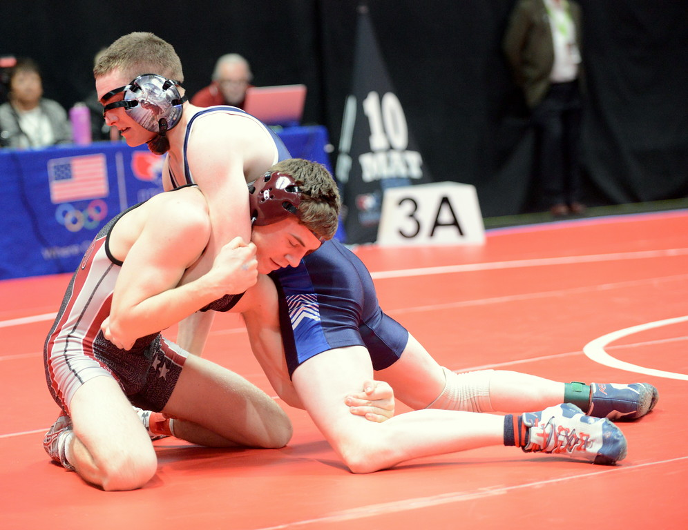. Brock Leypoldt looks for a scoring sequence in his 138-pound match with Daniel Caddy of Moffat County at the 3A state wrestling tournament at the Pepsi Center in Denver. Caddy won by decision. (Mike Brohard/Loveland Reporter-Herald)