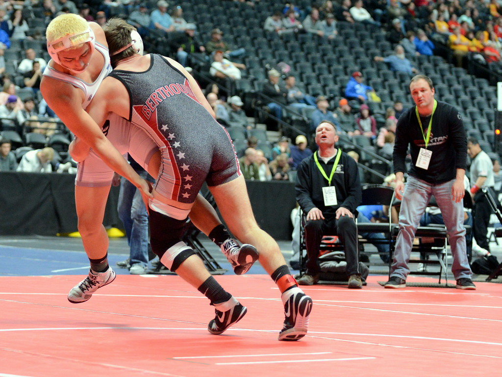 . Brock Johnson of Berthoud takes Skyview\'s Daniel Agosto to the mat on his way to an 8-2 decision in their 170-pound match at the 3A state wrestling tournament at the Pepsi Center in Denver. (Mike Brohard/Loveland Reporter-Herald)