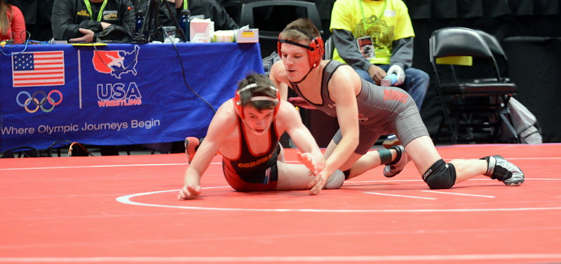 Isaac Lujan of Loveland hits a takedown in his 7-2 victory over Seth Garcia of Coronado at 126 pounds at the 4A state wrestling tournament Thursday at the Pepsi Center in Denver. (Mike Brohard/Loveland Reporter-Herald)