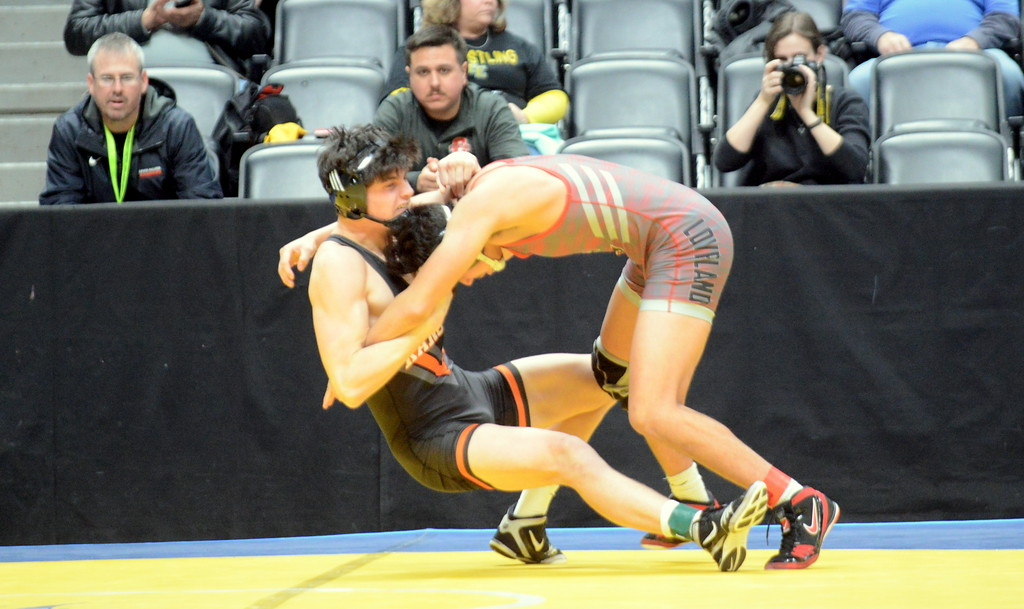 . Loveland\'s Marcelo Espinoza-Diaz looks for a takedown in his 170-pound match with Jake Martin of Lewis Palmer at the 4A state wrestling tournament Thursday at the Pepsi Center in Denver. Martin won by fall in :35. (Mike Brohard/Loveland Reporter-Herald)