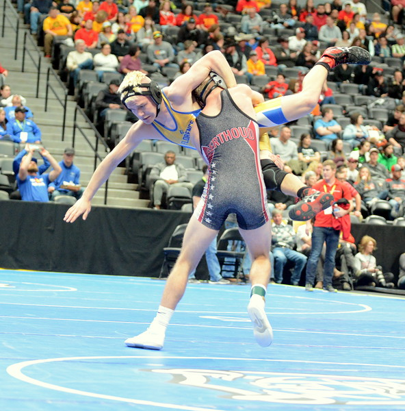 Austyn Binkly of Berthoud lifts jacob Kennedy of Florence on his way to a takedown in their 145-pound match Thursday at the 3A state wrestling tournament at the Pepsi Center in Denver. Binkly won with a 16-1 technical fall. (Mike Brohard/Loveland Reporter-Herald)