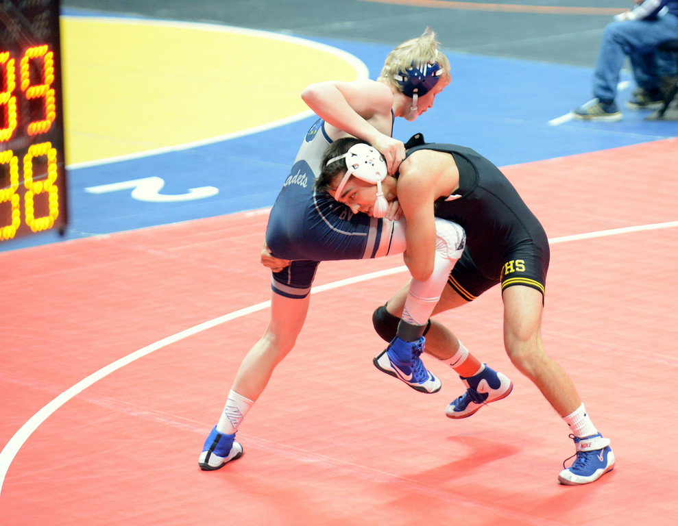 . Thompson Valley 138-pounder Johnathan Walker hits a single-leg takedown in his 10-4 loss to Air Academy\'s Bailey Badwound at the 4A state wrestling tournament Thursday at the Pepsi Center in Denver. (Mike Brohard/Loveland Reporter-Herald)