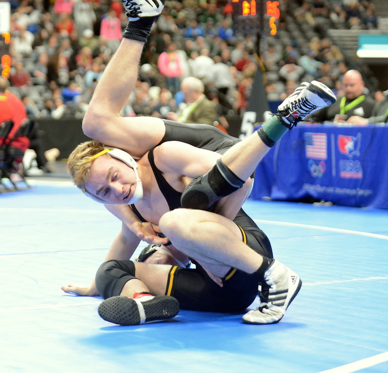 . Thompson Valley\'s Jay McLaughlin comes through a scramble with Tanner Sukle of Discovery Canyon to get a takedown in his 8-3 decision at 152 pounds at the 4A state wrestling tournament Thursday at the Pepsi Center in Denver. (Mike Brohard/Loveland Reporter-Herald)