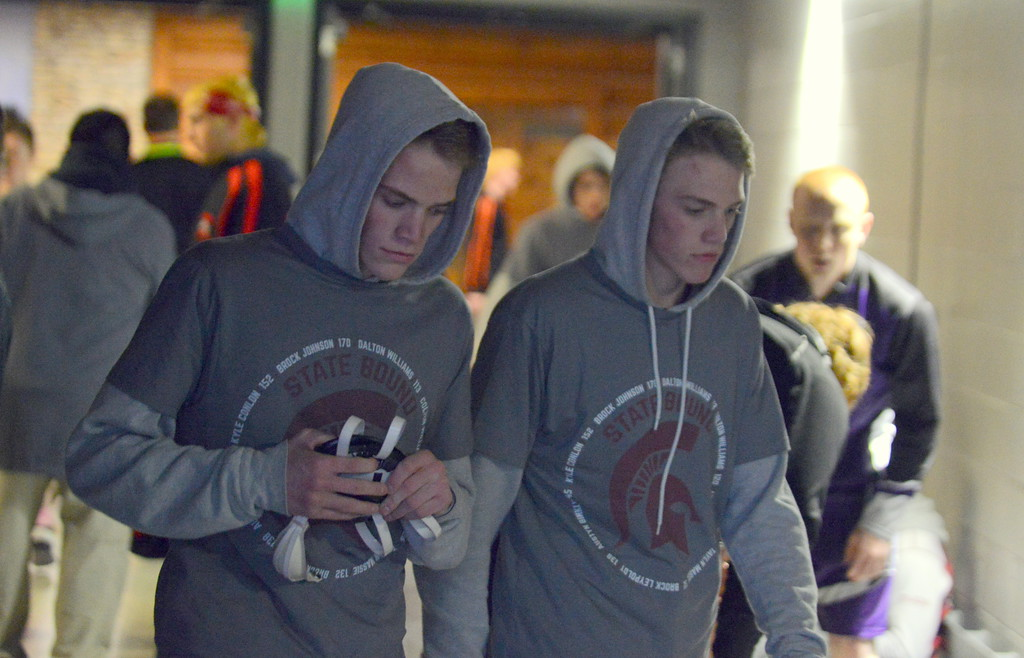 . Berthoud twins Dalton and Colton Williams pace in the tunnel as they wait for Thursday\'s start to the 3A state wrestling tournament at the Pepsi Center in Denver. Both advanced with pins. (Mike Brohard/Loveland Reporter-Herald)