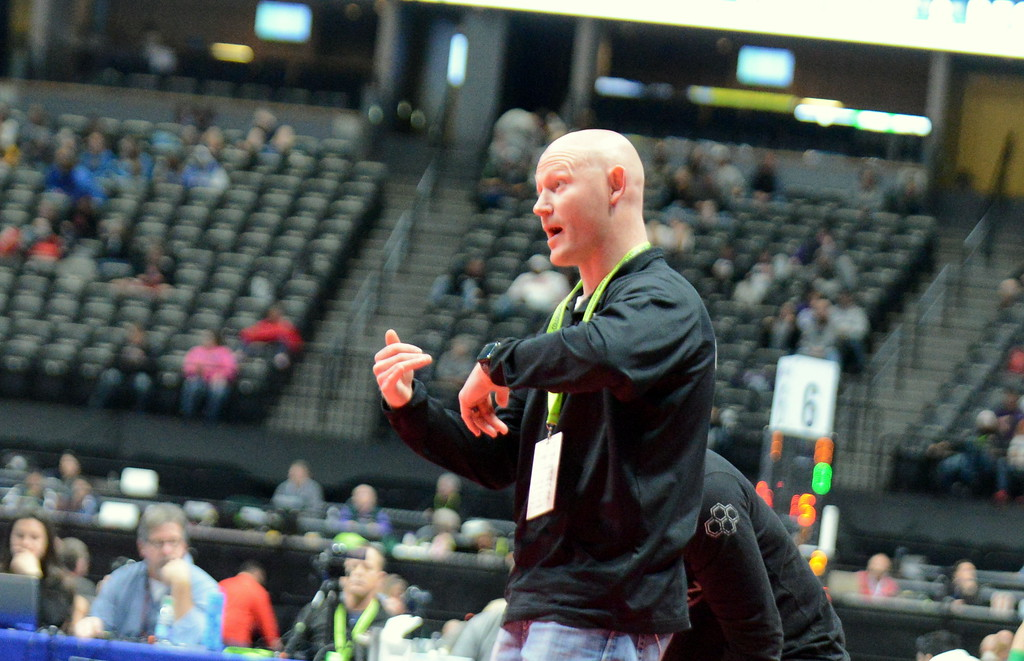 . Berthoud coach Will Carron gives instruction to Colton Williams during his match at the 3A state wrestling tournament at the Pepsi Center in Denver. (Mike Brohard/Loveland Reporter-Herald)