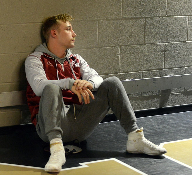 Berthoud senior Austyn Binkly passes the time in the tunnel before the start of the 3A state wrestling tournament at the Pepsi Center in Denver. (Mike Brohard/Loveland Reporter-Herald)