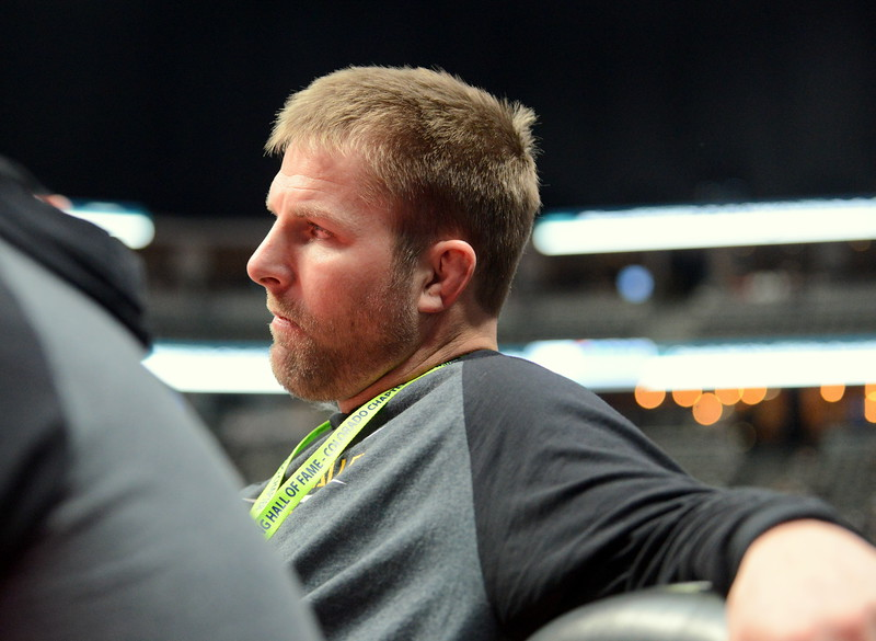 Thompson Valley coach Steve Gerrard kicks back and watches as Chase Engelhardt takes control in his win at 160 pounds at the 4A state wrestling tournament Thursday at the Pepsi Center in Denver. (Mike Brohard/Loveland Reporter-Herald)