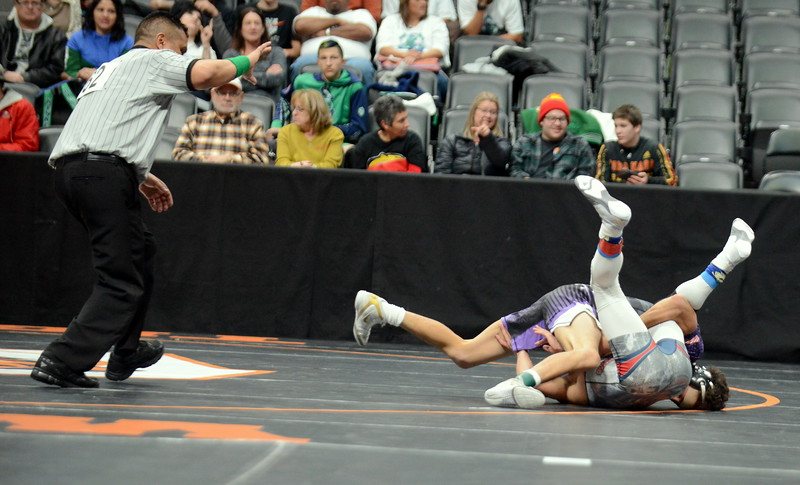 Malachi Contreras of Mountain View puts Charles Lyons of Sand Creek on his back en route to a pin in 2:43 of their 120-poound match at the 4A state wrestling tournament Thursday at the Pepsi Center in Denver. (Mike Brohard/Loveland Reporter-Herald)