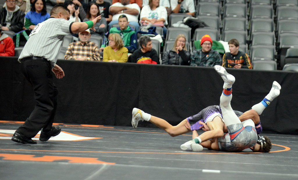 . Malachi Contreras of Mountain View puts Charles Lyons of Sand Creek on his back en route to a pin in 2:43 of their 120-poound match at the 4A state wrestling tournament Thursday at the Pepsi Center in Denver. (Mike Brohard/Loveland Reporter-Herald)