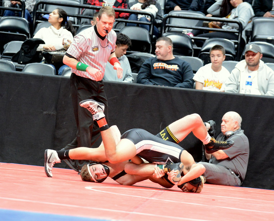 . Thompson Valley\'s Chase Engelhardt (bottom) gets tangled up with Pueblo South\'s Marcos Martinez at 160 pounds in the quarterfinal round of the 4A state tournament Friday at the Pepsi Center in Denver. Martinez won a 3-1 decision.  (Mike Brohard/Loveland Reporter-Herald)