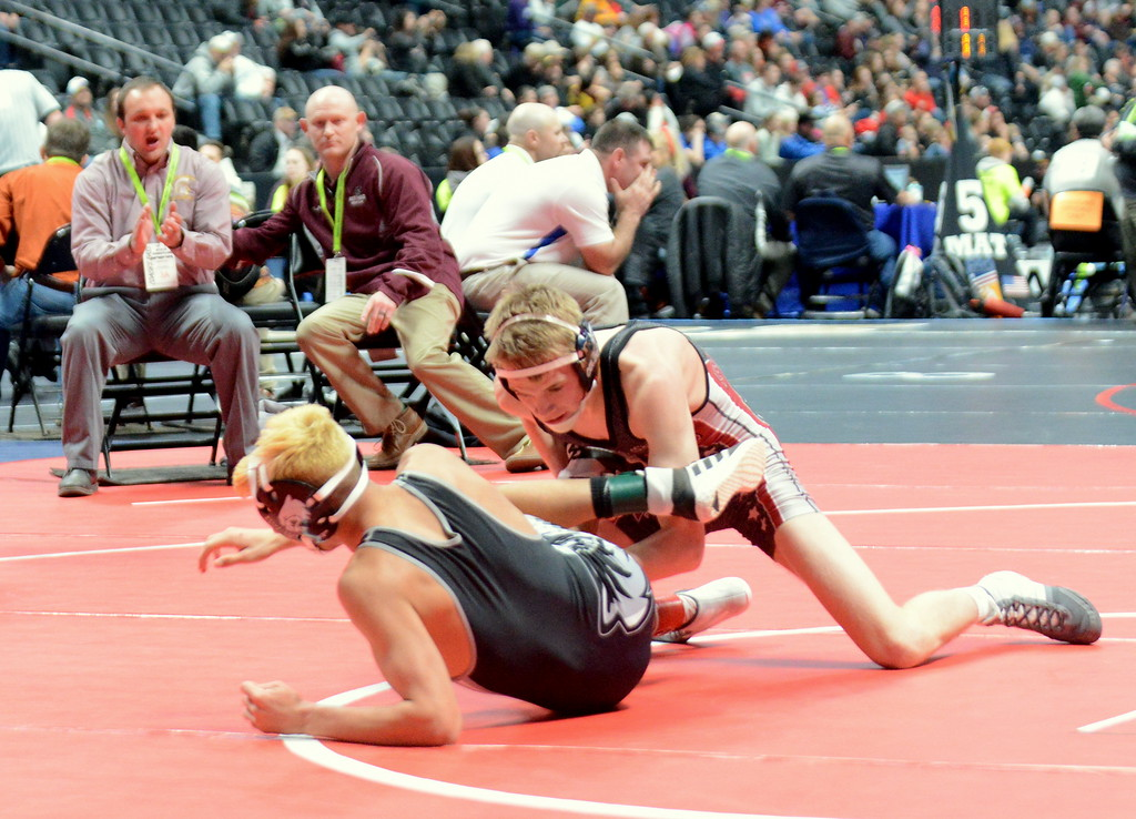 . Berthoud\'s Dalton Williams hits a takedown in his 11-9 victory over Skyview\'s Ezra Herrera in the second round of consolation at the 3A state wrestling tournament Friday at the Pepsi Center in Denver. (Mike Brohard/Loveland Reporter-Herald)