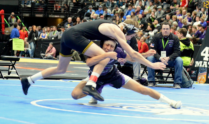 Malachi Contreras of Mountain View dives in for the first takedown of the night in his 120-pound 4A semifinal match with Thompson Valley's Airiel Siegel at the Colorado state wrestling tournament Friday night at the Pepsi Center in Denver. (Mike Brohard/Loveland Reporter-Herald)