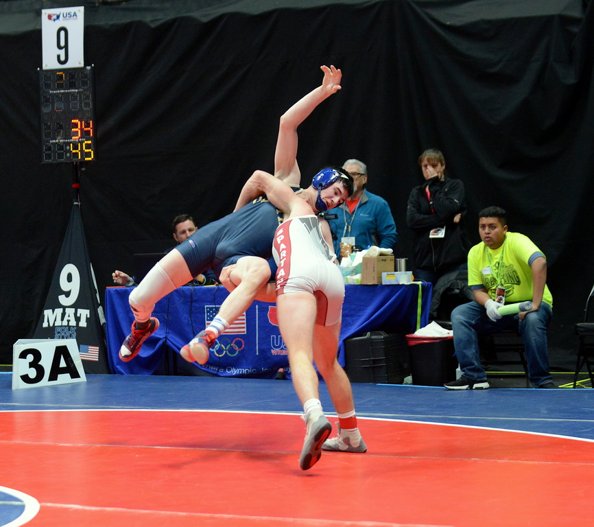 . Berthoud\'s Austyn Binkly throws Olathe\'s Clay Yarnell to the mat for the winning reversal in his 4-3 decision in the 3A 145-pound semifinals at the Colorado state wrestling tournament Friday night at the Pepsi Center in Denver. (Mike Brohard/Loveland Reporter-Herald)