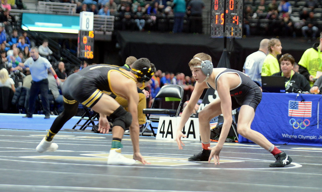 . Loveland\'s Cody Thompson squares off with Mac Martinez of Pueblo South at 113 pounds in the quarterfinal round of the 4A state tournament Friday at the Pepsi Center in Denver. Martinez won an 8-2 decision. (Mike Brohard/Loveland Reporter-Herald)\\