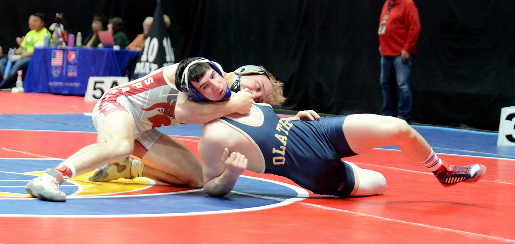 . Berthoud\'s Austyn Binkly tries to pull Olathe\'s Clay Yarnell to his back in their 3A 145-pound semifinal match at the Colorado state wrestling tournament Friday night at the Pepsi Center in Denver. (Mike Brohard/Loveland Reporter-Herald)