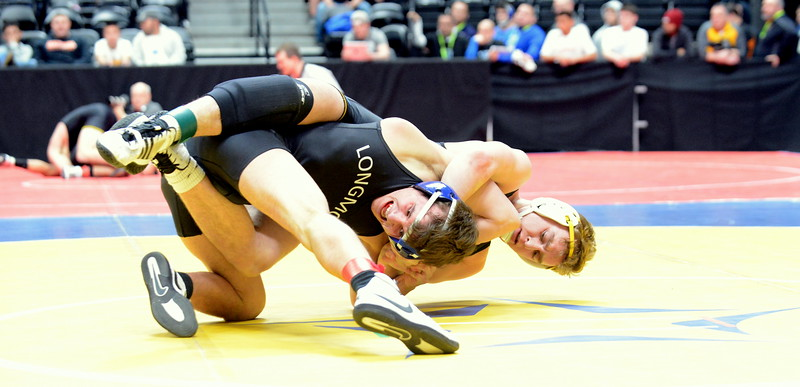 Thompson Valley's Jay McLaughlin goes on the hunt for back points in his 152-pound match with Longmont's Brayden Engelking in the quarterfinal round of the 4A state tournament Friday at the Pepsi Center in Denver. Engelking won by fall in 3:09. (Mike Brohard/Loveland Reporter-Herald)