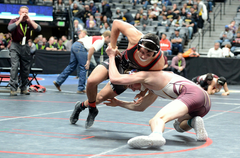 . Berthoud\'s Kyle Conlon goes low on Jackson Contreras of Eaton for a takedown after scoring an escape in his 6-2 victory in the second round of consolation at the 3A state wrestling tournament Friday at the Pepsi Center in Denver. (Mike Brohard/Loveland Reporter-Herald)