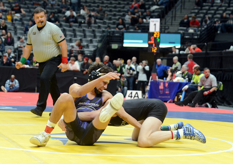 Malachi Contreras of Mountain View hits a switch on his way to a 6-0 decision at 120 pounds against Longmont's John Nicholas in the quarterfinal round of the 4A state tournament Friday at the Pepsi Center in Denver. Contreras will have a rematch with Thompson Valley's Airiel Siegel in the semifinals. (Mike Brohard/Loveland Reporter-Herald)