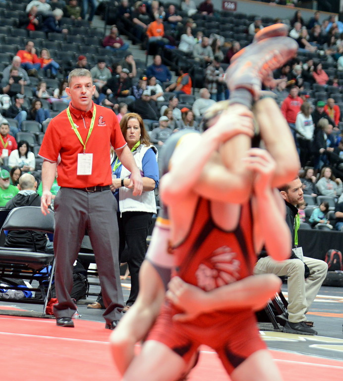 . Loveland coach Troy Lussenhop looks on as Kobi Johnson goes for a takedown at 106 pounds in the quarterfinal round of the 4A state tournament Friday at the Pepsi Center in Denver. (Mike Brohard/Loveland Reporter-Herald)