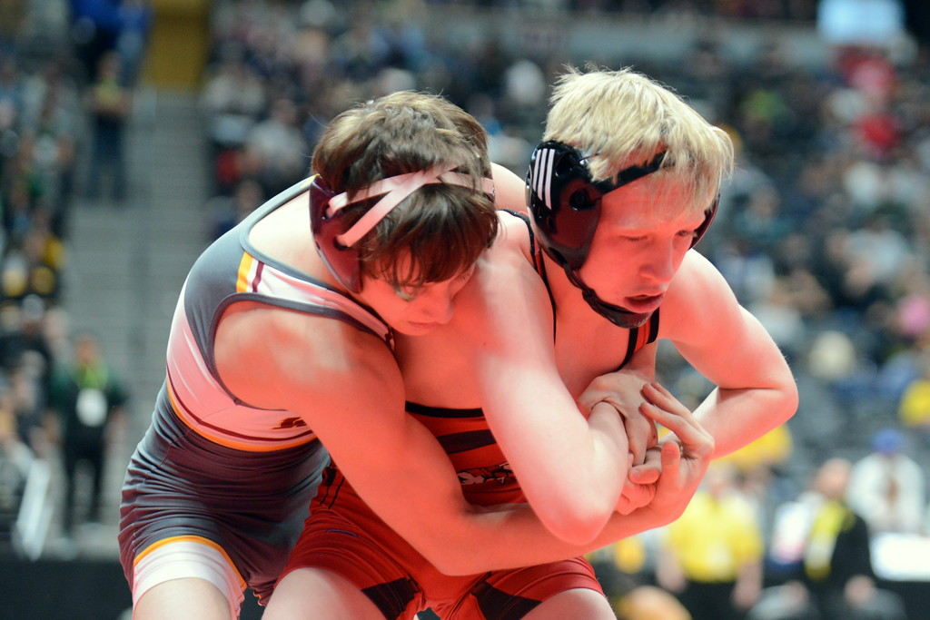 . Loveland\'s Kobi Johnson (right) tries to break the grip of Windsor\'s Brady Parker in their 4A 106-pound match in the quarterfinal round of the 4A state tournament Friday at the Pepsi Center in Denver. (Mike Brohard/Loveland Reporter-Herald)