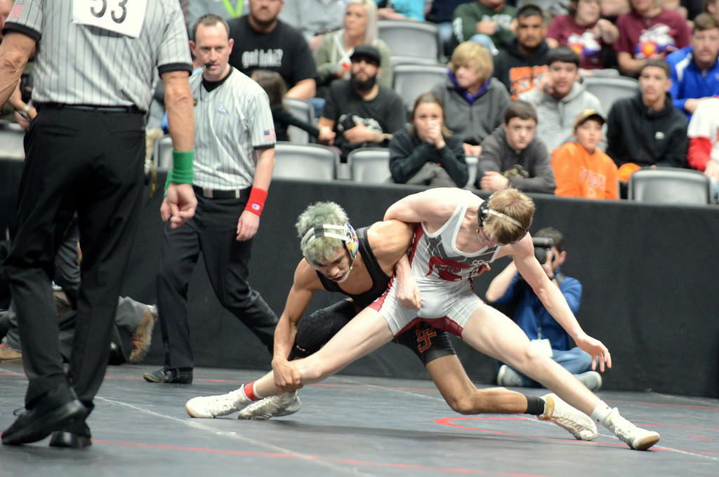 . Colton Williams of Berthoud gets stretched out in his 120-pound 3A semifinal match with La Junta\'s Isaiah Gamez at the Colorado state wrestling tournament Friday night at the Pepsi Center in Denver. Gamez won by pin in 3:04. (Mike Brohard/Loveland Reporter-Herald)