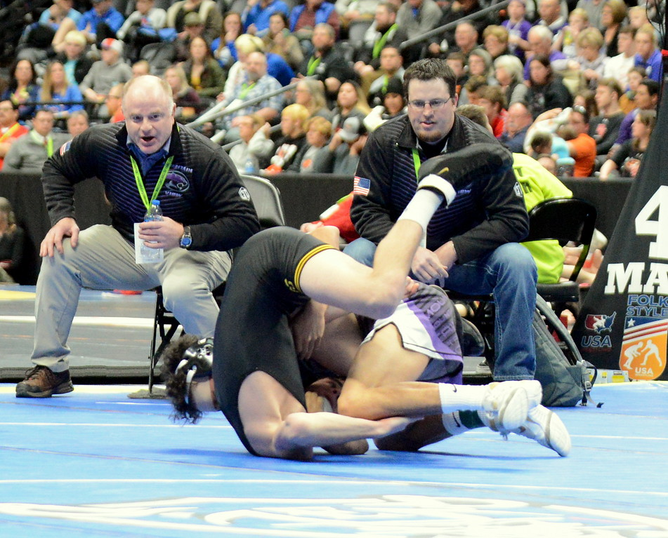 . Mountain View\'s Malachi Contreras ties to stack Thompson Valley\'s Airiel Siegel in their 120-pound 4A semifinal match at the Colorado state wrestling tournament Friday night at the Pepsi Center in Denver. (Mike Brohard/Loveland Reporter-Herald)