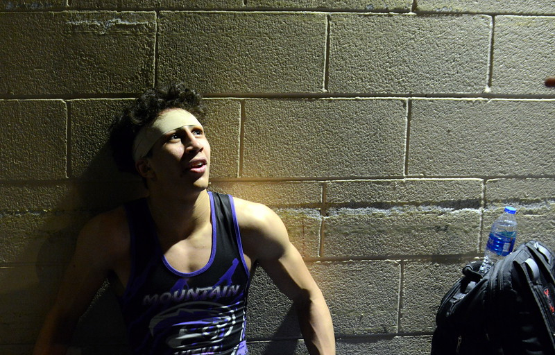 Mountain View's Malachi Contreras catches his breath in the tunnel as he listens to coach Scott Barker after his 120-pound win in the quarterfinal round of the 4A state tournament Friday at the Pepsi Center in Denver. (Mike Brohard/Loveland Reporter-Herald)