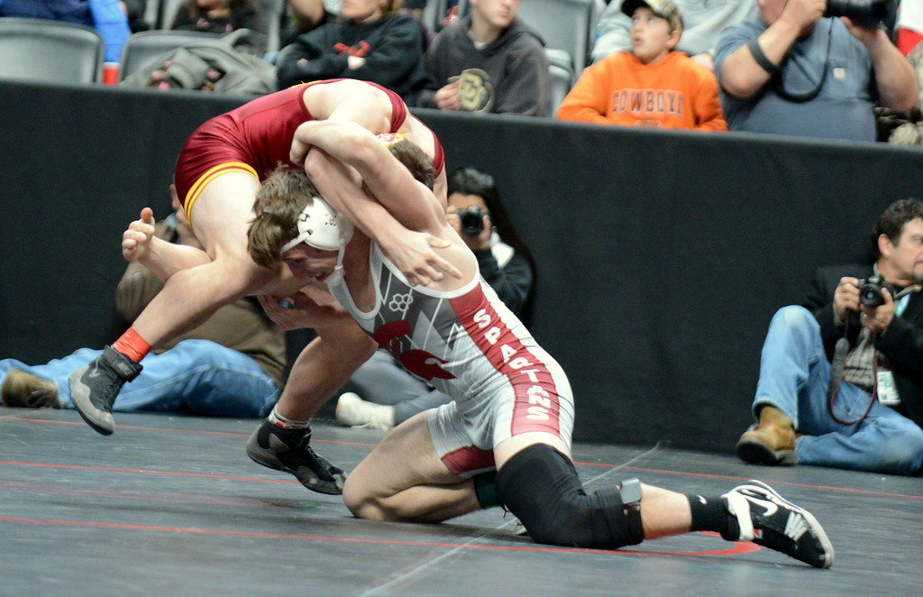 . Berthoud\'s Brock Johnson shoots on Wyatt Pfau of Brush in their 3A 170-pound semifinal match at the Colorado state wrestling tournament Friday night at the Pepsi Center in Denver. Pfau won by fall in 4:32. Mike Brohard/Loveland Reporter-Herald)