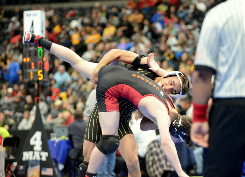 Thompson Valley 138-pounder Johnathan Walker follows through on a single leg and dumps Ben Nagel of Coronado for a takedown en route to a 7-2 decision in the 4A fifth-place match on Saturday at the state wrestling tournament at the Pepsi Center in Denver. (Mike Brohard/Loveland Reporter-Herald)