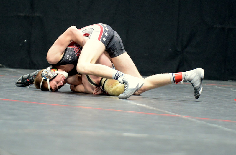Berthoud's Dalton Williams starts to turn Brandon Boehm of Florence on his was to a 14-0 major decision to take fifth-place at 113 pounds in 3A on Saturday at the state wrestling tournament at the Pepsi Center in Denver. (Mike Brohard/Loveland Reporter-Herald)