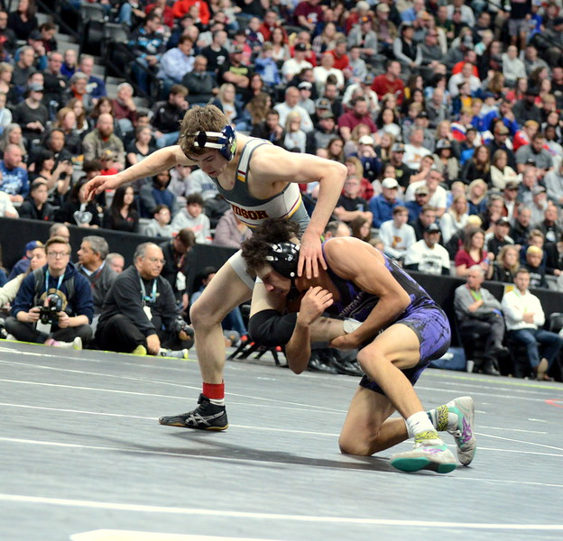 Mountain View's Malachi Contreras keeps hold of the leg of Windsor's Will Vombaur in their 4A 120-pound final at Saturday's finals of the Colorado State Wrestling Tournament at the Pepsi Center in Denver. (Mike Brohard/Loveland Reporter-Herald)
