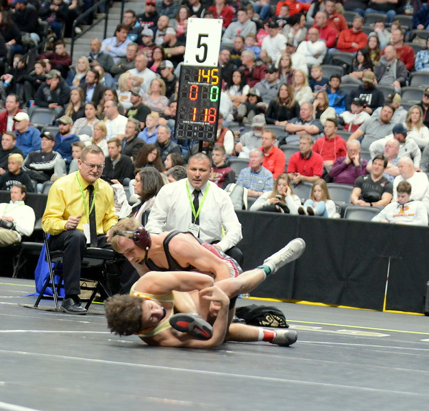 Berthoud's Austyn Binkly scores the first takedown of the 3A 145-pound final with Cameron Lucero of Pagosa Springs at Saturday's finals of the Colorado State Wrestling Tournament at the Pepsi Center in Denver. Lucero would take an 8-2 decision.  (Mike Brohard/Loveland Reporter-Herald)