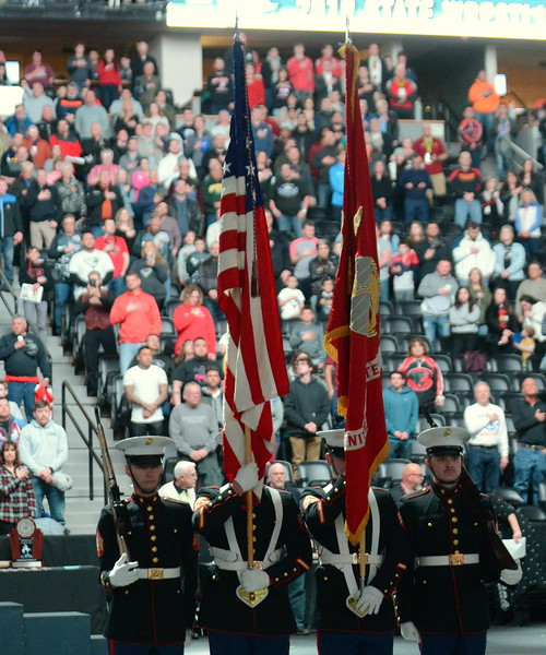 Marines present the colors for the National Anthem at Saturday's finals of the Colorado State Wrestling Tournament at the Pepsi Center in Denver. (Mike Brohard/Loveland Reporter-Herald)