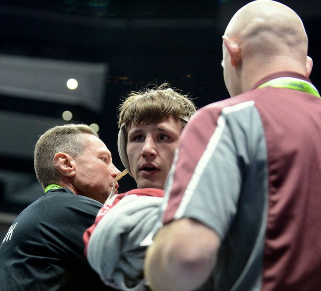 Berthoud's Brock Johnson is congratulated by assistant coach Faren Stroh (left) and head coach Will Carron after taking third in 3A at 170 pounds on Saturday at the state wrestling tournament at the Pepsi Center in Denver. (Mike Brohard/Loveland Reporter-Herald)